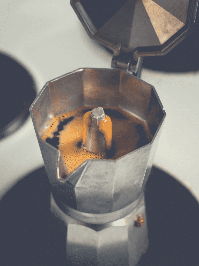 opened moka pot with brewed coffee inside, how to brew coffee without a coffee maker