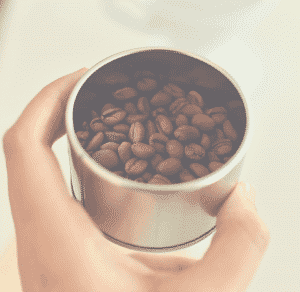 1 cup of coffee beans in a metal cup