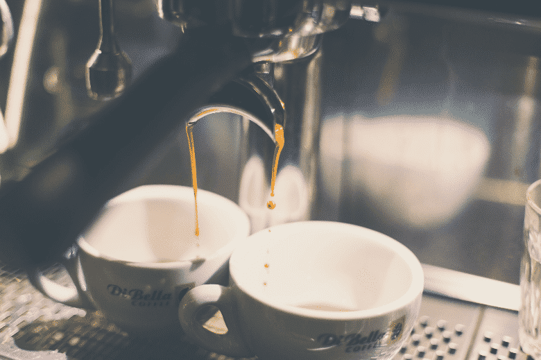 two cups of espresso extraction from an espresso machine