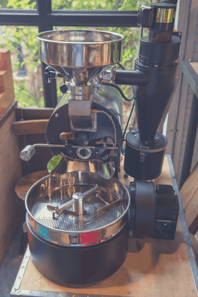 Roasting machine. Spinning cooler professional machine. Industry concept . Freshly roasted machine coffee beans, slow roast vs fast roast