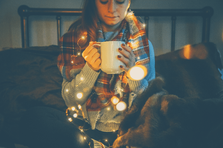 lady in shawl with a cup of coffee