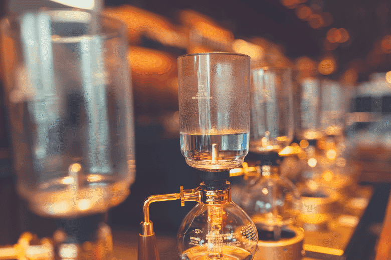 a row of siphon coffee apparatus