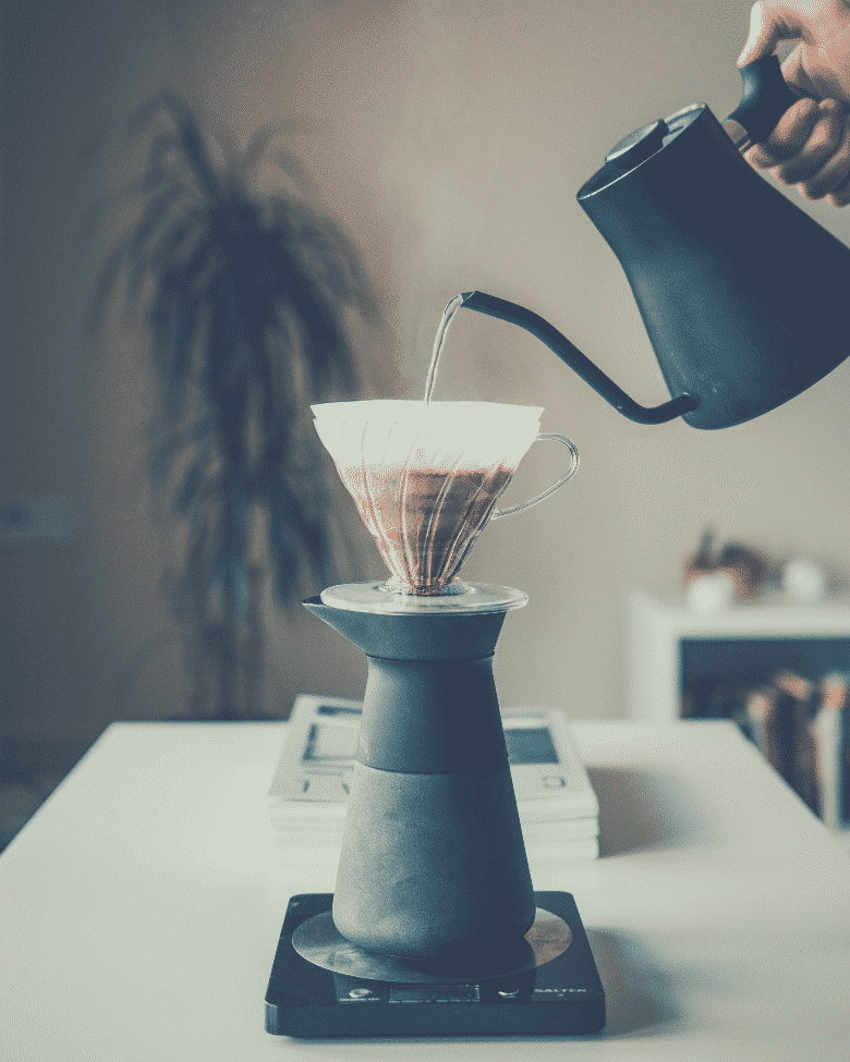 pouring boiling water over a coffee cone