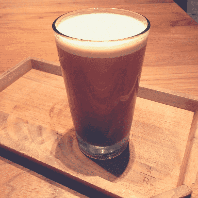 nitro cold brew in a cup on a tray