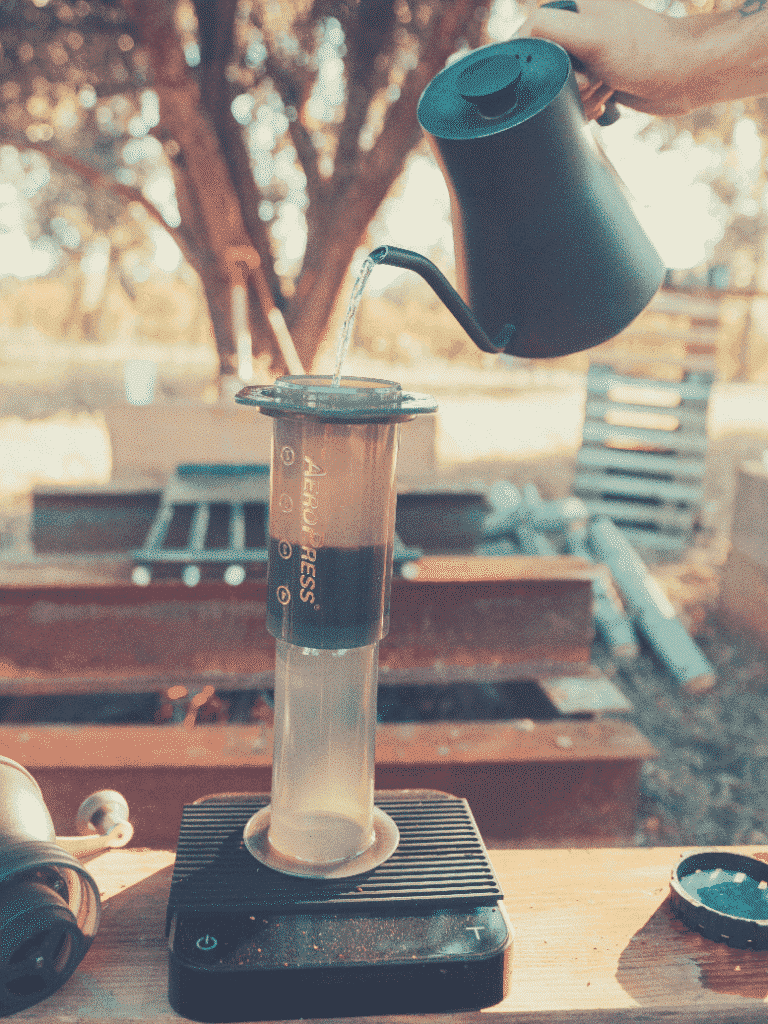 pouring hot water into aeropress apparatus