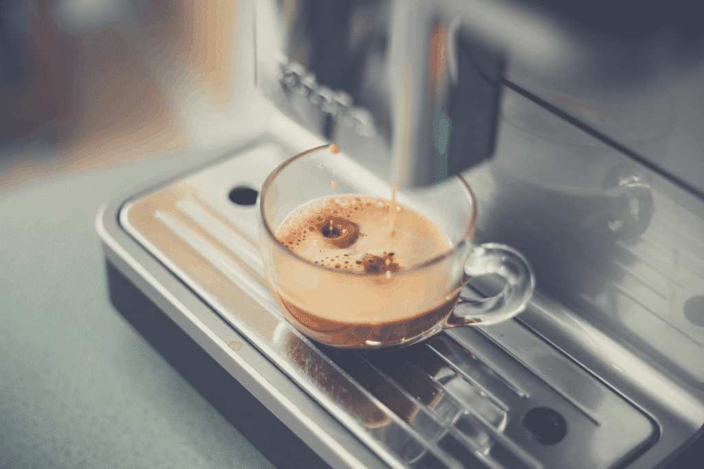 a super automatic espresso machine brewing a cup of espresso in a clear glass cup, gaggia brera