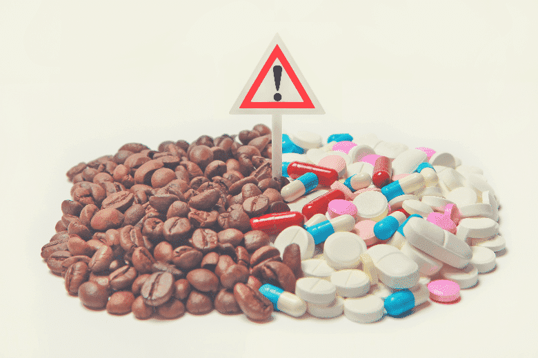 a pile of coffee beans and medication drugs and pills
