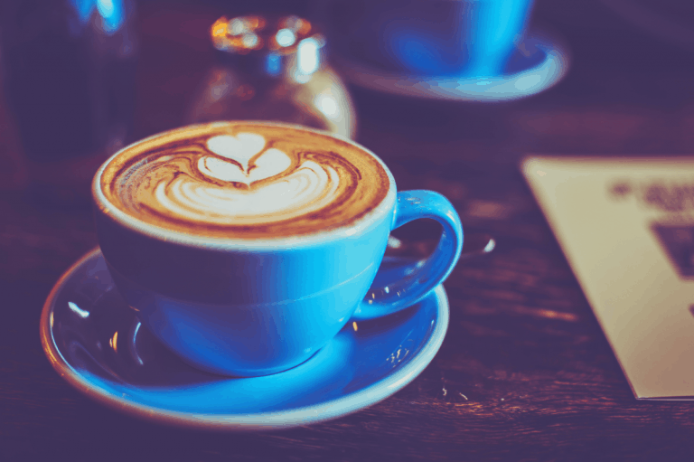 photo of blue ceramic coffee cup and saucer, cappuccino cups