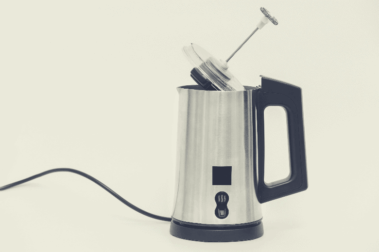 The milk foam maker is automatic. The frother is made of stainless steel with a black plastic top, handle, buttons and power cord, best milk frother
