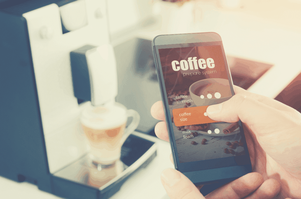 Making coffee from smartphone, modern coffee maker, smart coffee maker