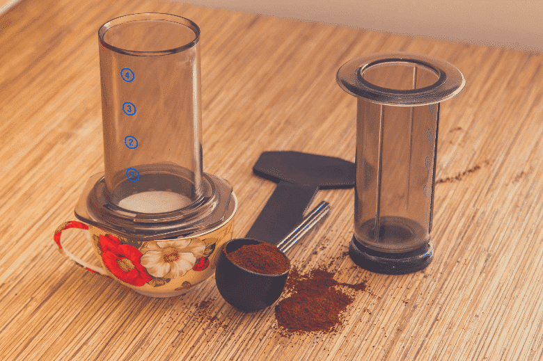 Preparation of ground coffee in aeropress - portable filter coffee maker, how to brew coffee without a coffee maker