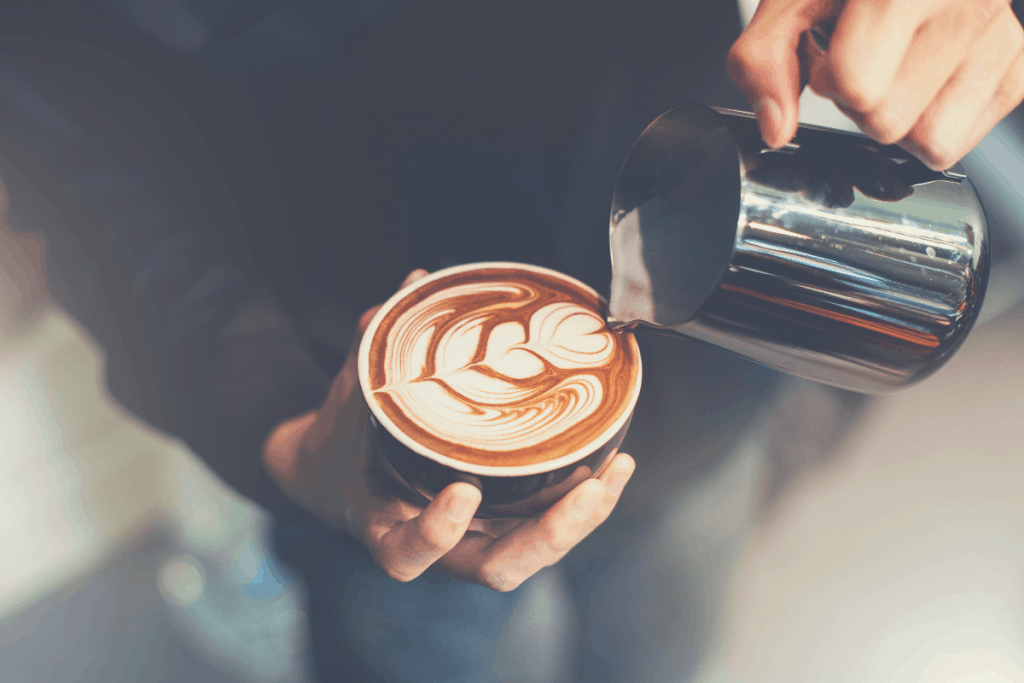 Barista make coffee cup latte art, how to make coffee art with milk