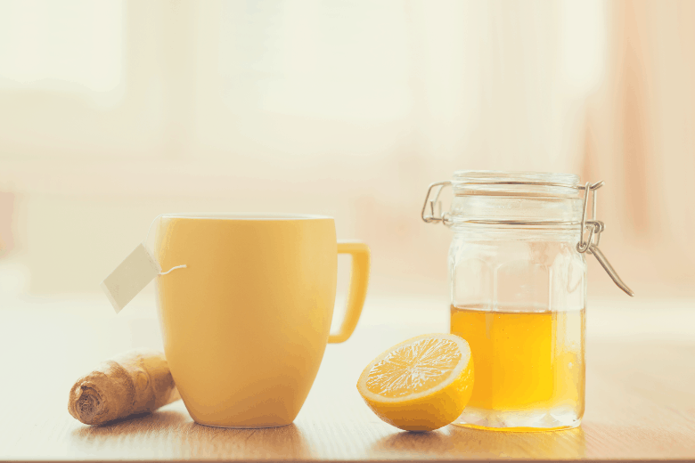 Detail of honey and lemon with sunny house interior in background, best ways to sweeten coffee
