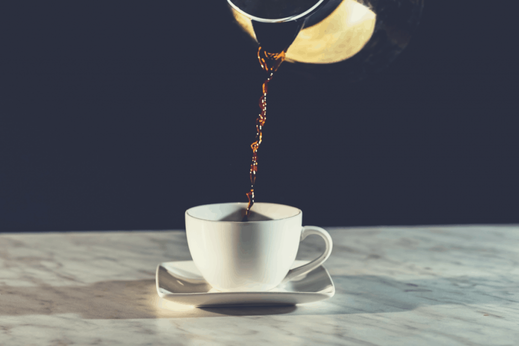 pouring coffee into a white cup, how to brew coffee without a coffee maker