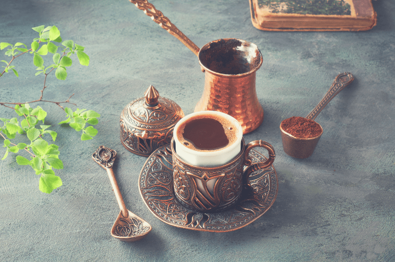 Oriental coffee cooked in traditional Turkish copper coffee pot and served in a matching cup, how to brew coffee without a coffee maker