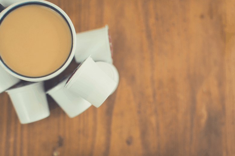 cup of coffee and pods on wooden table, are k cups instant coffee