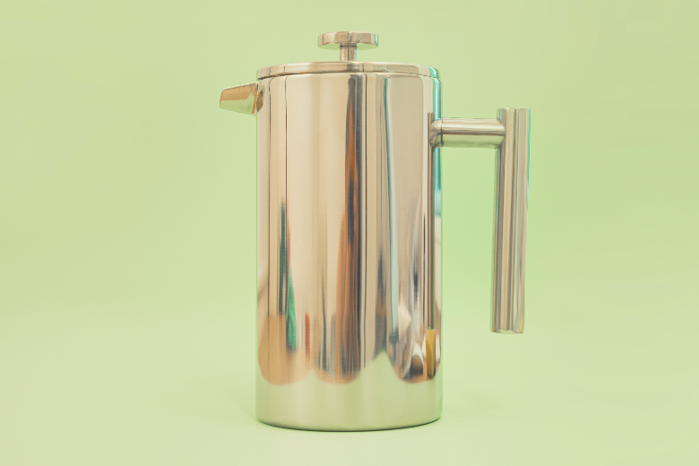 Totally made from stainless steel frenchpress stays on a light green background. Filter. Design. Kitchen. Tea. Coffee. Handle. Preparation. Useful. Device