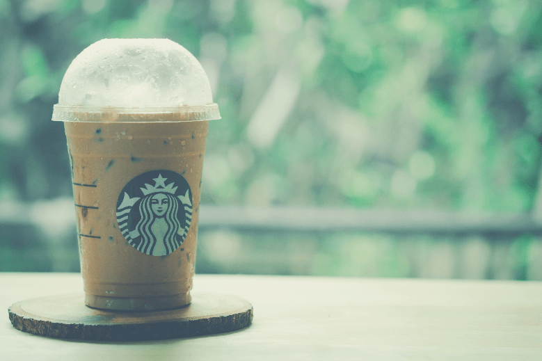iced mocha in takeaway glass from Starbucks coffee shop on a wooden table, starbucks decaf drinks