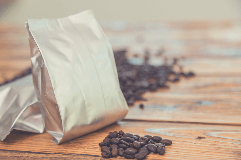 New coffee foil bag on wood table, how to reuse coffee bags