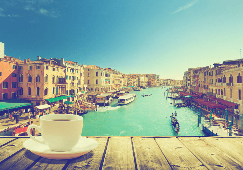 coffee on table and Venice in sunset time, Italy, why does Italian coffee taste different