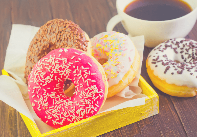 variety of donuts and black coffee