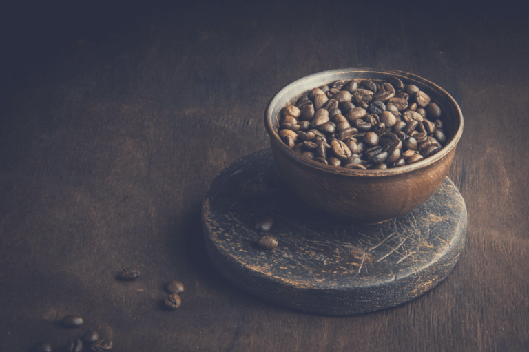 coffee beans in a cup on a brown background, how many coffee beans in a cup of coffee